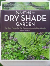 Book cover of Planting the Dry Shade Garden by Graham  Rice